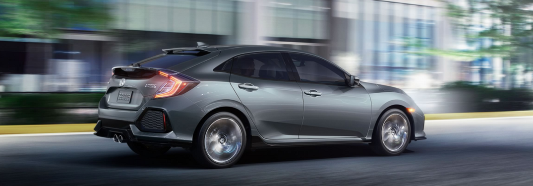 Side view of a 2018 Honda Civic Hatchback driving by