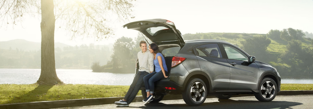 2018 Honda HR-V parked on side of road with couple in trunk hatch