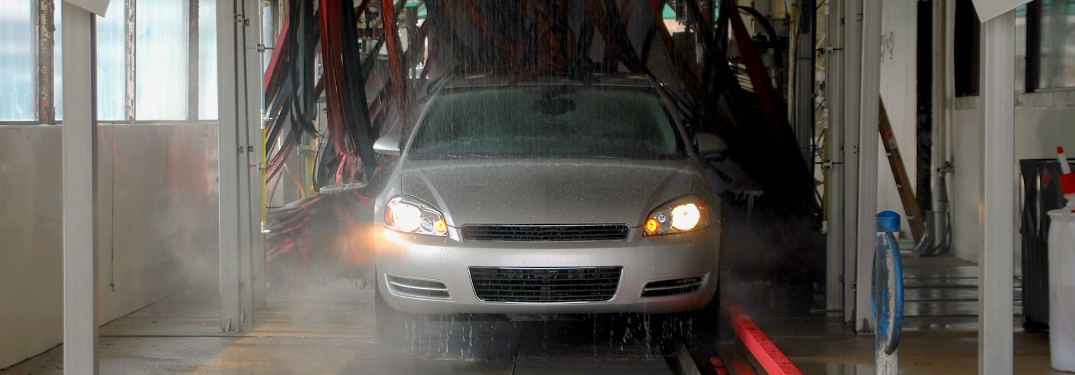 Silver Sedan Riding through a Car Wash