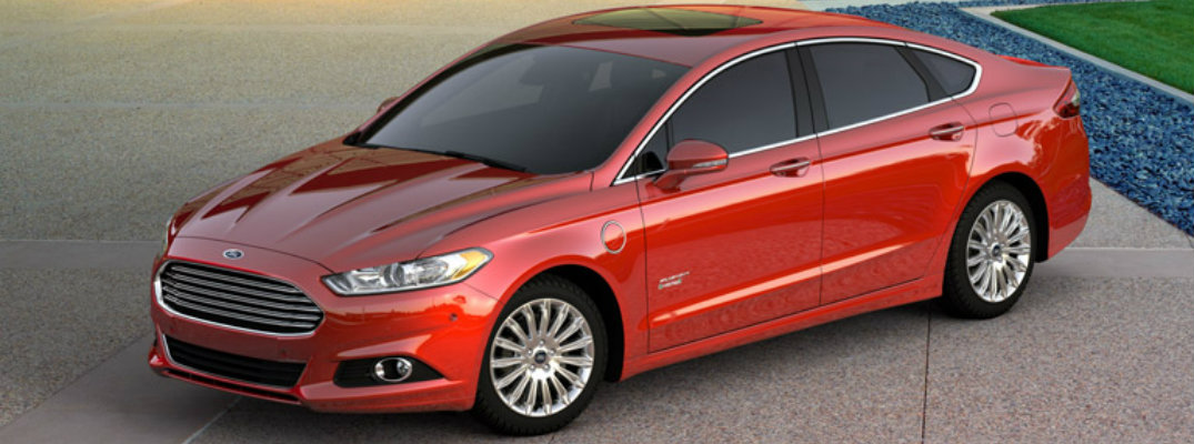 Exterior view of a red 2016 Ford Fusion parked outside on a sunny day