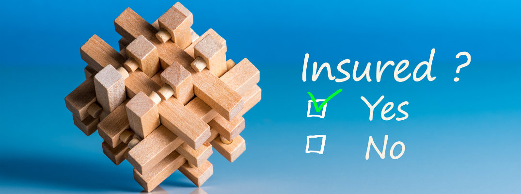 Image of a wood 3D puzzle with text about insurance