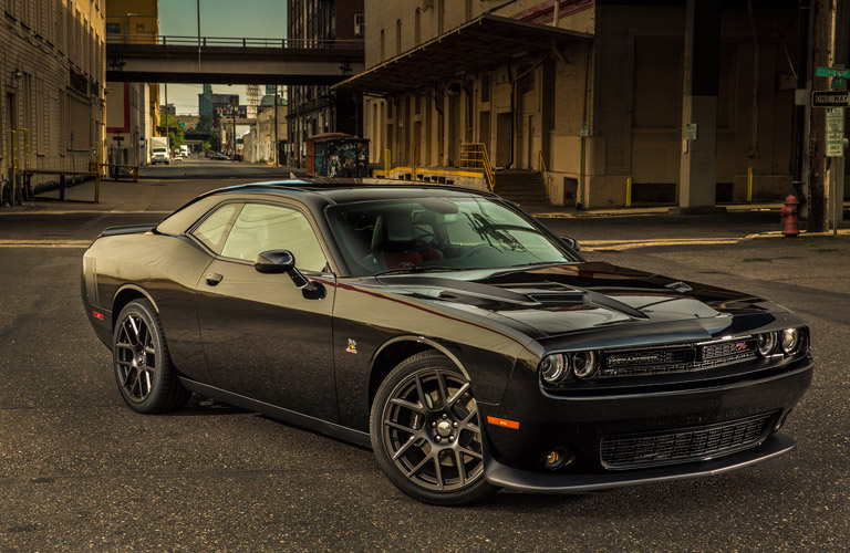 Exterior view of a black 2016 Dodge Challenger parked on a city street