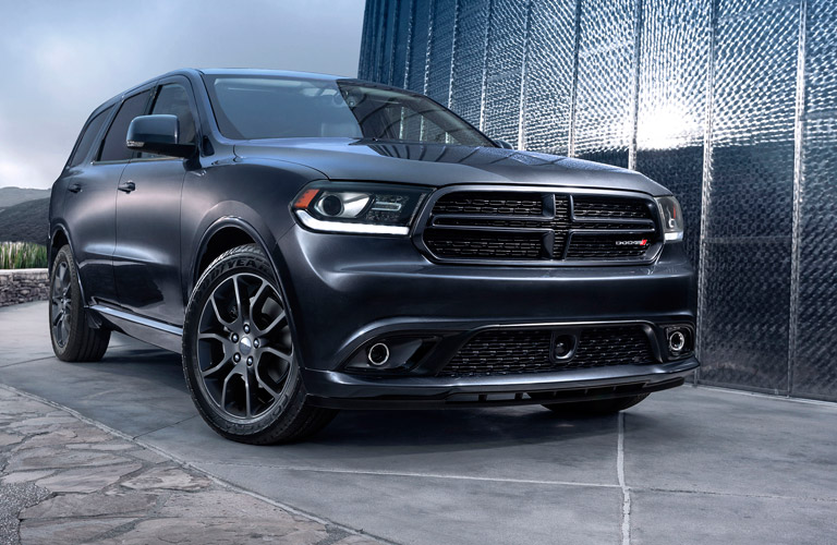 Exterior view of a black 2016 Dodge Durango parked outside an office building