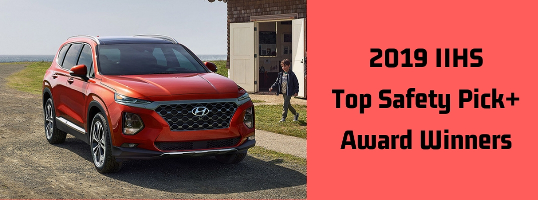 """Image of a red 2019 Hyundai Santa Fe to the right of black font against a red background stating """"2019 IIHS Top Safety Pick+ Award Winners"""""""