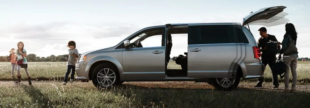 Family getting out of the 2019 Dodge Grand Caravan