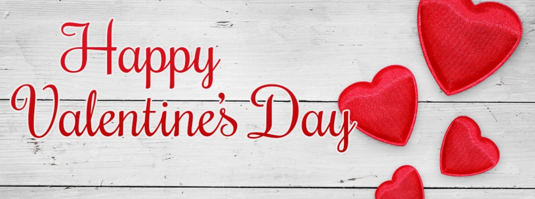 Happy Valentine's Day in red script font against a wood background