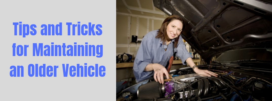 """Image of a female mechanic working on a car with """"Tips and Tricks for Maintaining an Older Vehicle"""" in blue text against a grey background"""
