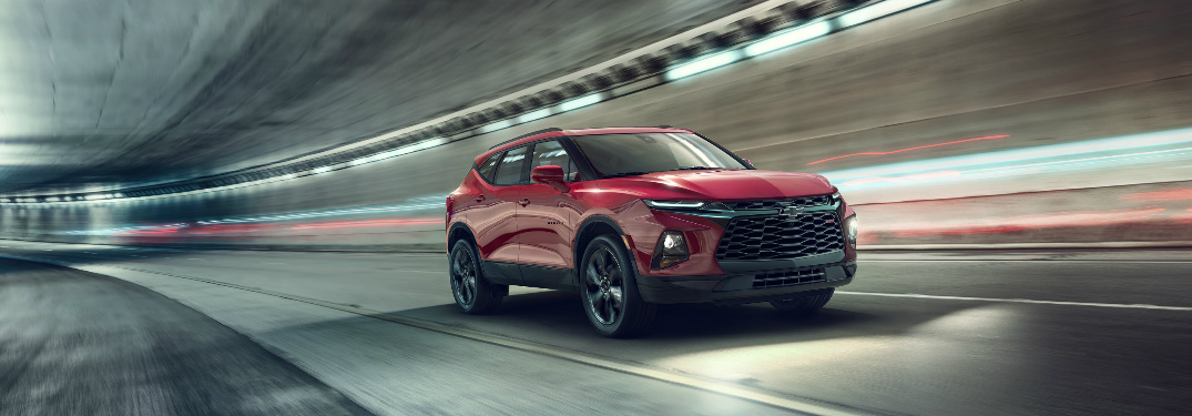 2019 Chevy Blazer in red driving through a blurred tunnel