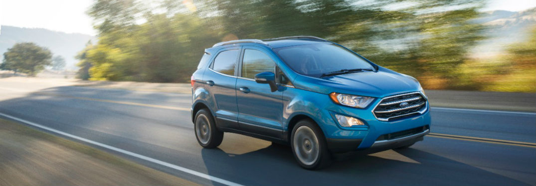 Ford Ecosport In Blue Driving Down A Sunny Country Road