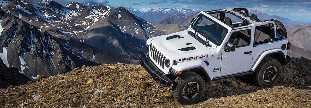 2019 Jeep Wrangler parked on the peak of a mountain