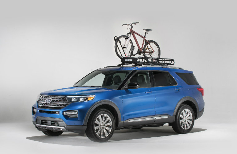 2020 Ford Explorer in blue with Yakima bike rack and bike