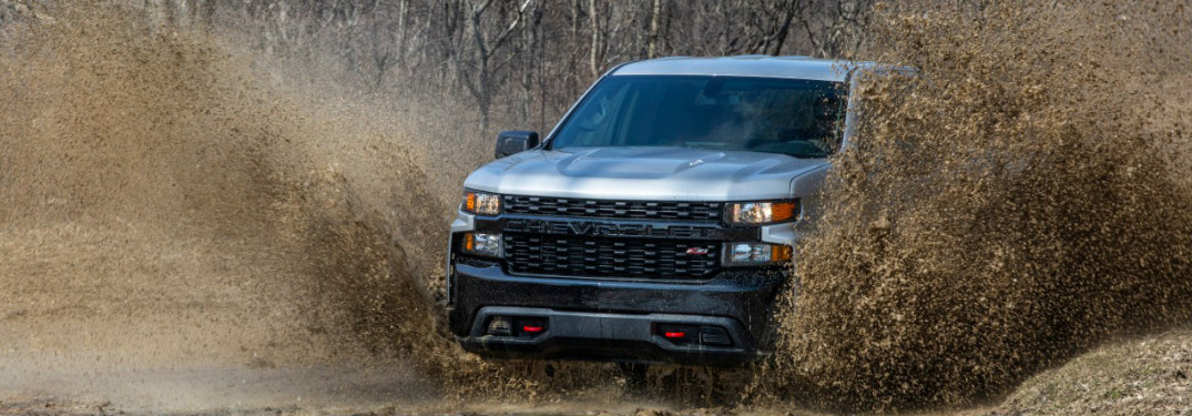 2020 Chevy Silverado Trail Boss kicking up muddy water