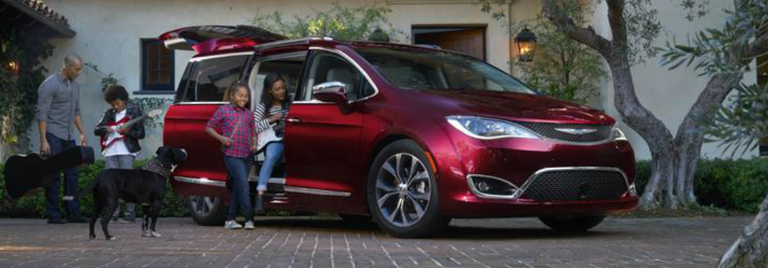 family gathered around the 2018 Chrysler Pacifica