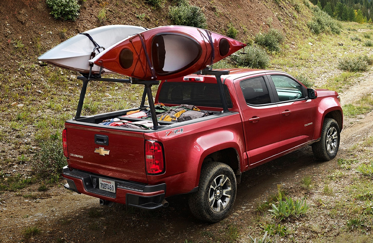 2020 Chevrolet Colorado with kayaks going up a hill