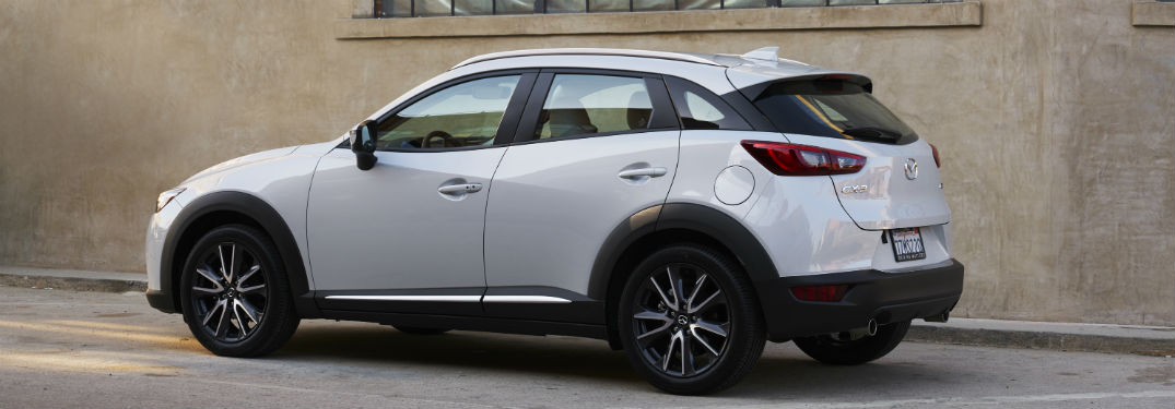 2018 Mazda CX-3 exterior back fascia and drivers side parked next to building wall