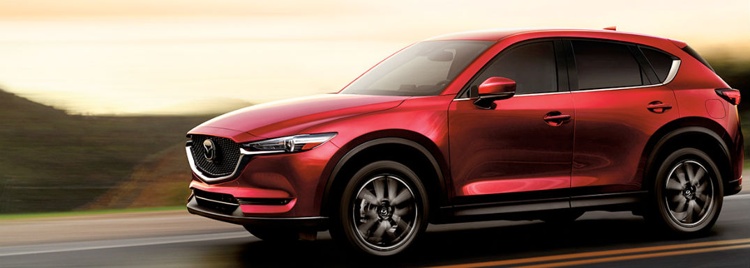 2018 Mazda CX-5 exterior front fascia and drivers side profile going fast on road