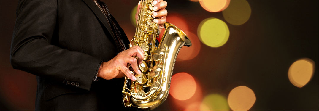 saxophone with jazz with hands and light spotted background
