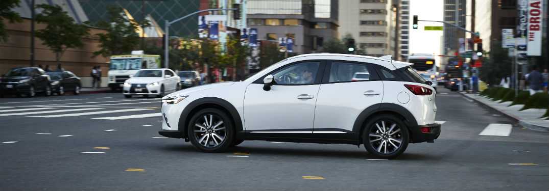 2018 Mazda CX-3 exterior driver side profile crossing intersection on city road