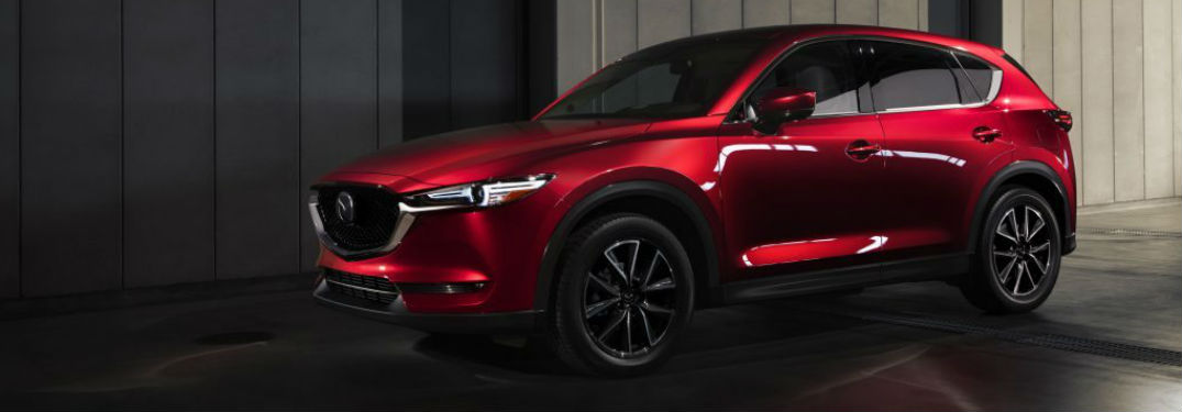 2018 Mazda CX-5 exterior front fascia and drivers side with dramatic lighting