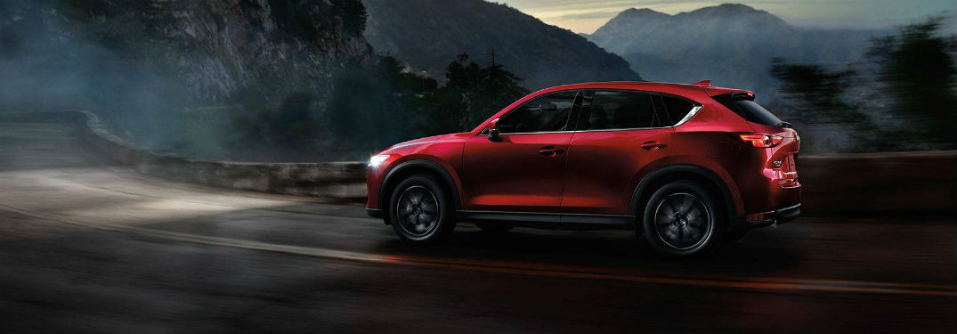 2018 Mazda CX-5 small suv driving at night with headlights on