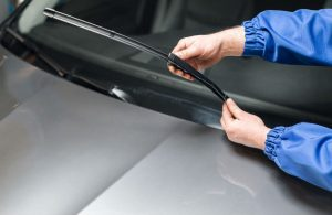 Windshield wiper being installed