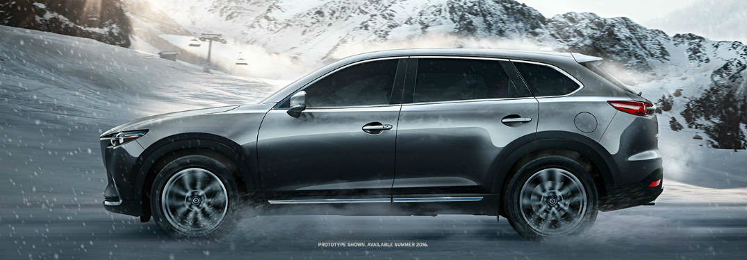 Mazda CX-9 driving on a snow-covered road
