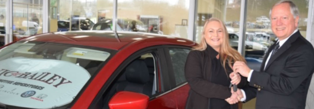 Sheila, a nurse with Medical Group of the Carolinas - Family Medicine in Duncan, is pictured here with Vic Bailey, III. standing next to a 2014 Mazda3