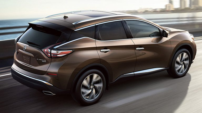 2016 Nissan Murano driving on a highway toward a city