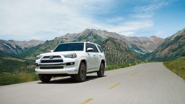 2018 Toyota 4Runner driving on a road between two mountains