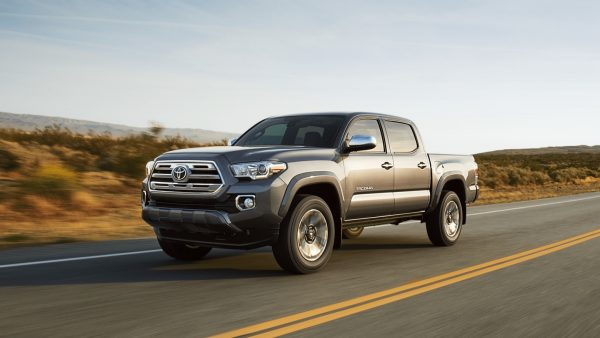 2018 Toyota Tacoma driving on the highway in an arid enviroment