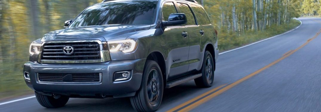 2018 Toyota Sequoia driving on a highway near a forest