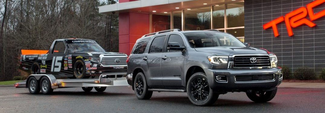2018 Toyota Sequoia towing a trailer with a Toyota Tundra on a trailer