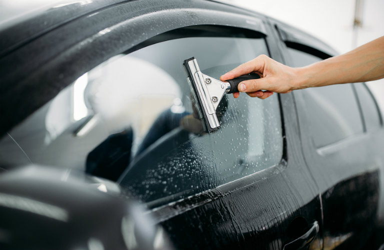 Cleaning Car Window with Squeegee