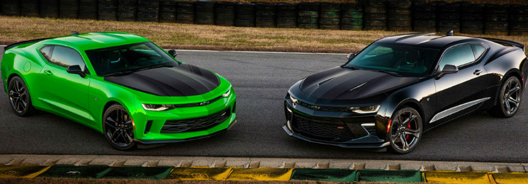 Two Chevy Camaro's parked on a track