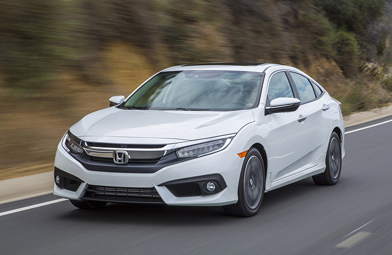 Honda Civic Driving On A Road