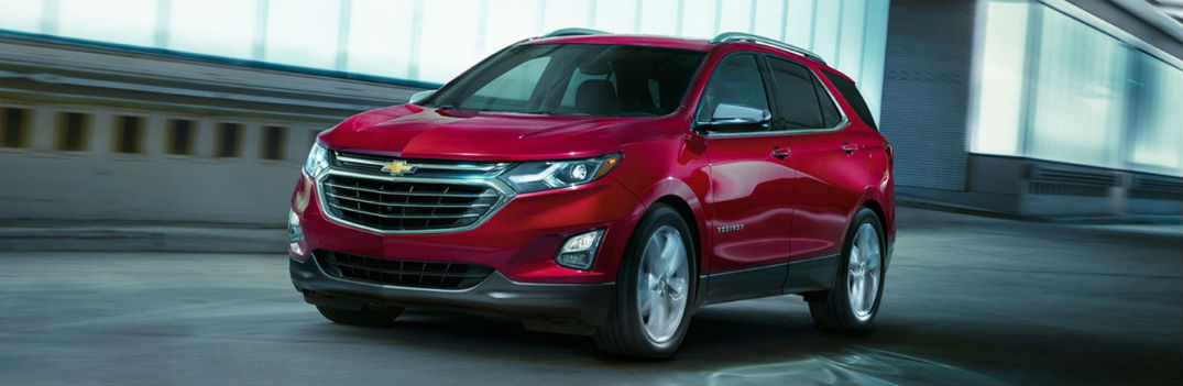 Chevy Equinox driving on a road
