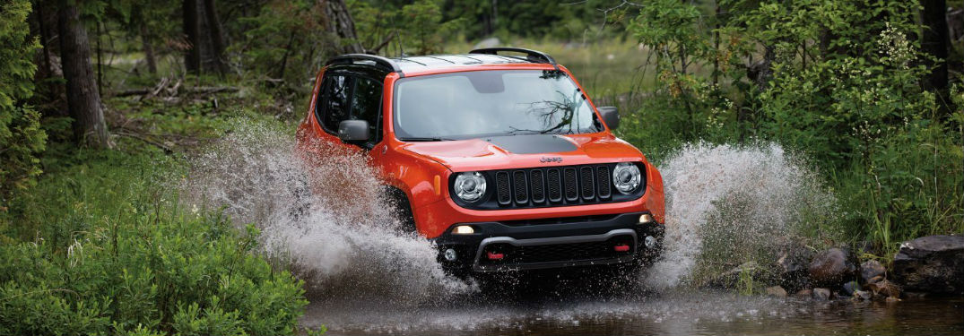 Jeep Renegade driving through a creek