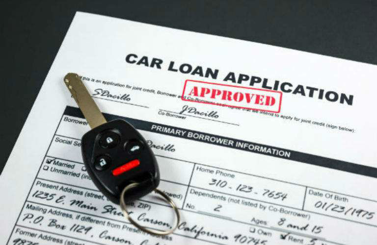Car loan application with keys on it