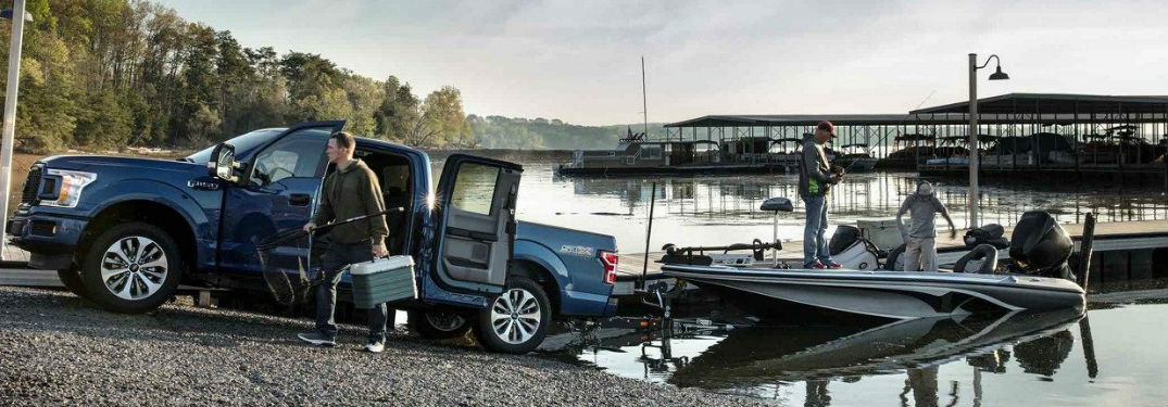 Ford F-150 towing a boat out of the water