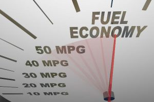 A gauge with fuel economy and mpg numbers on it