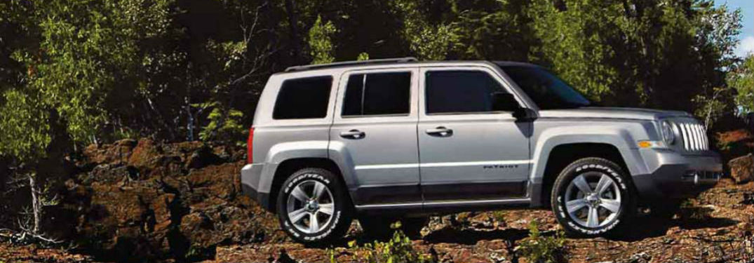 Jeep Patriot parked on some rocks