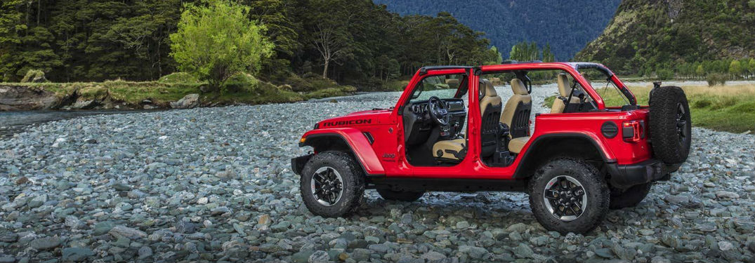 Jeep Wrangler Unlimited parked on some rocks