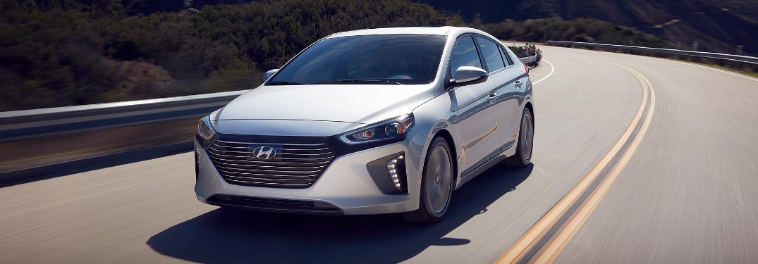 Front driver angle of a white 2019 Hyundai Ioniq driving down a road