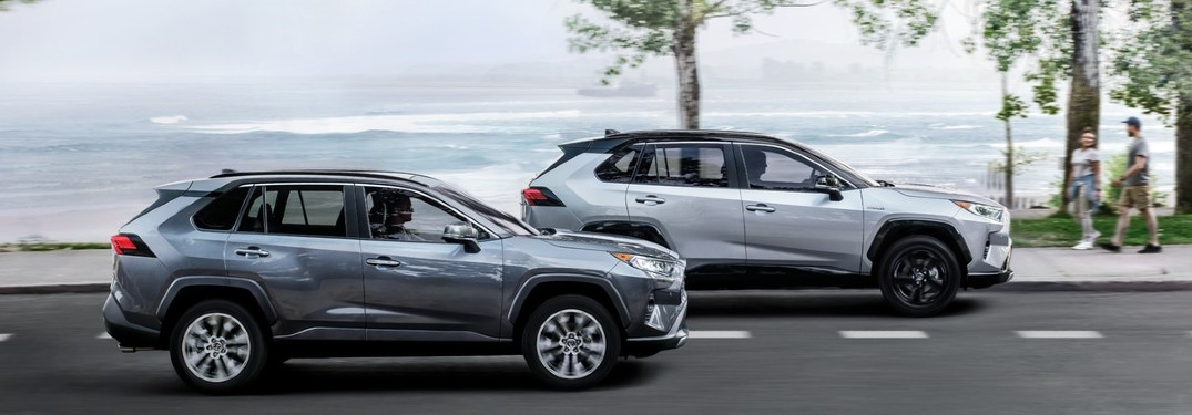 Two 2020 Toyota RAV4 vehicles driving next to each other on a road