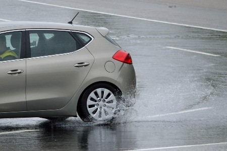 Rear angle of a car driving in rain