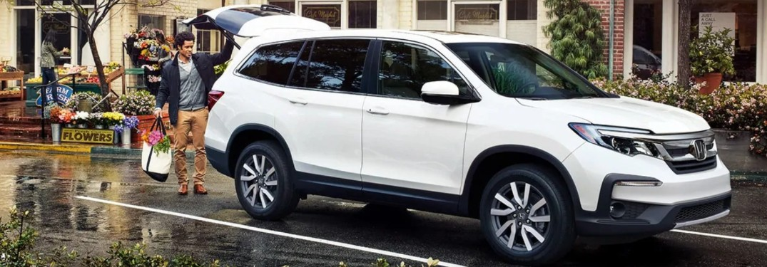 Front passenger angle of a white 2020 Honda Pilot with its liftgate open