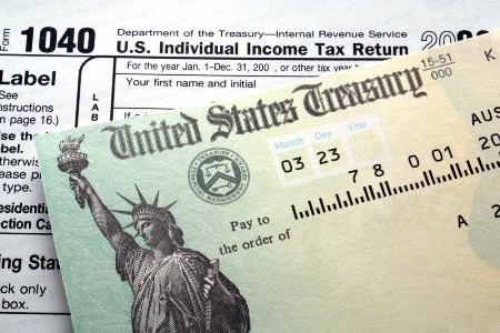 Tax return check on top of a tax form