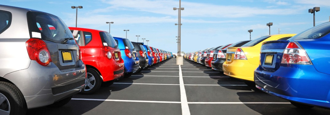 Rear angle of cars parked in a parking lot