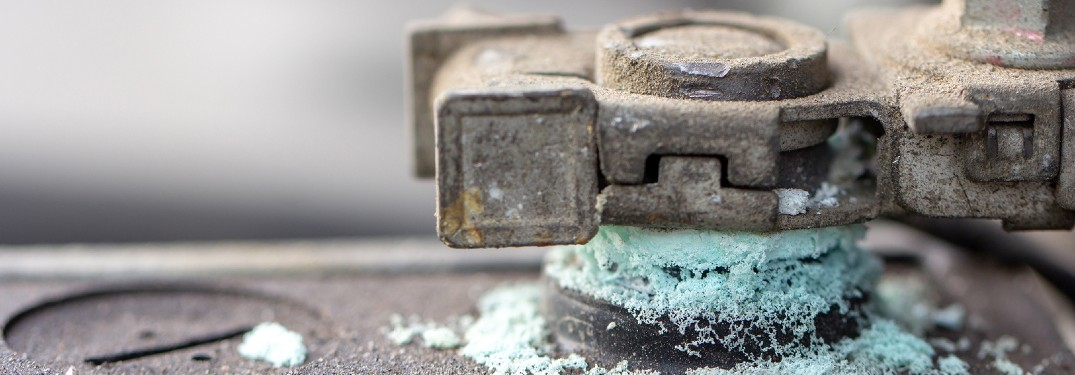 Close up of corrosion on a car battery terminal