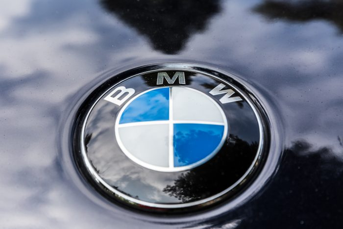 close up of the BMW logo on the hood of a bmw vehicle